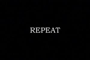 """immagine con scritta """"Repeat"""""""